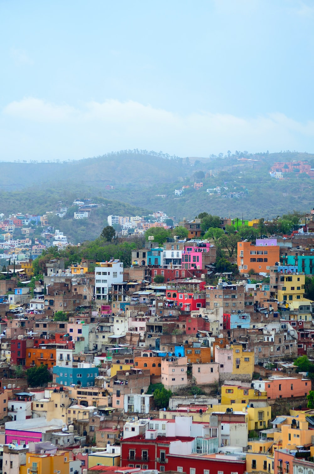 aerial photography of assorted-color buildings on top of mountain during daytime