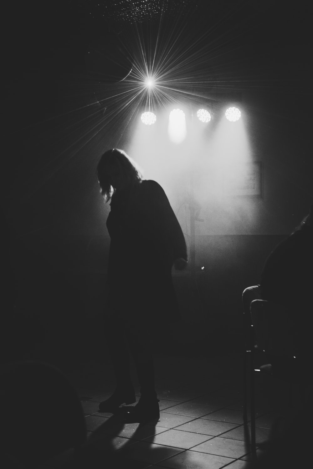 grey-scale photo of a person in a stage close-up photography