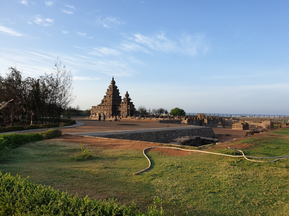 landscape photo of a temple ruin by green fields