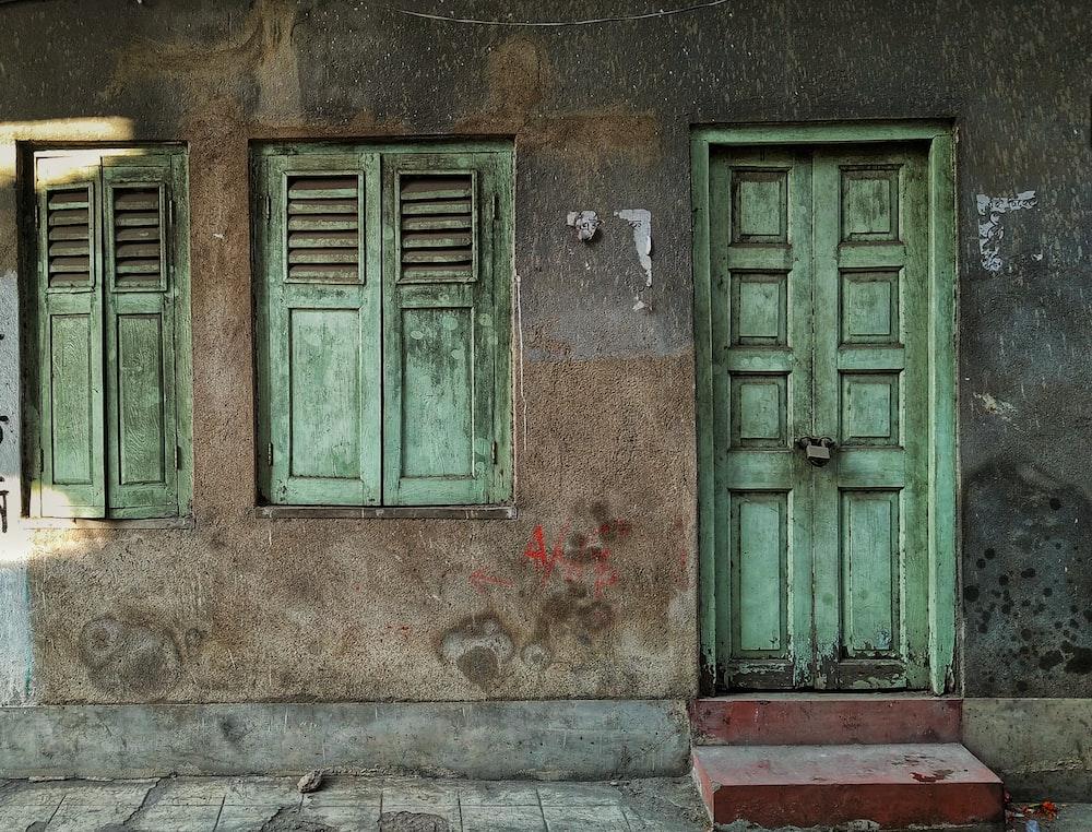 green wooden 8-panel door