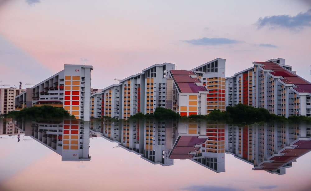 reflection photography of three buildings