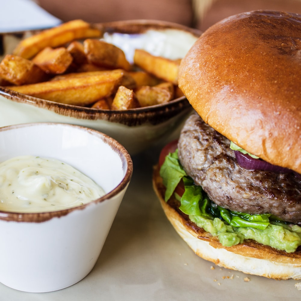 burger with green leafy vegetable and fries