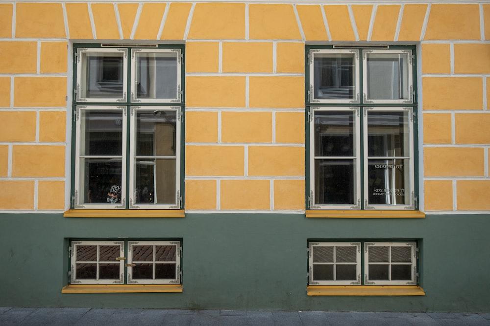 orange concrete building showing closed windows