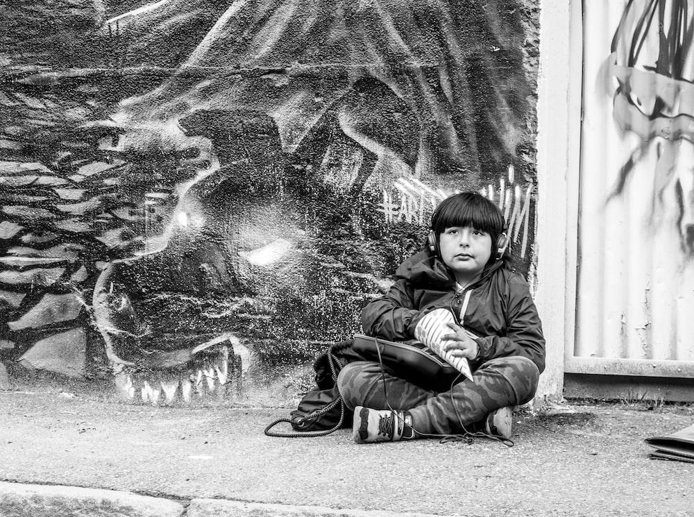 boy sits on the street