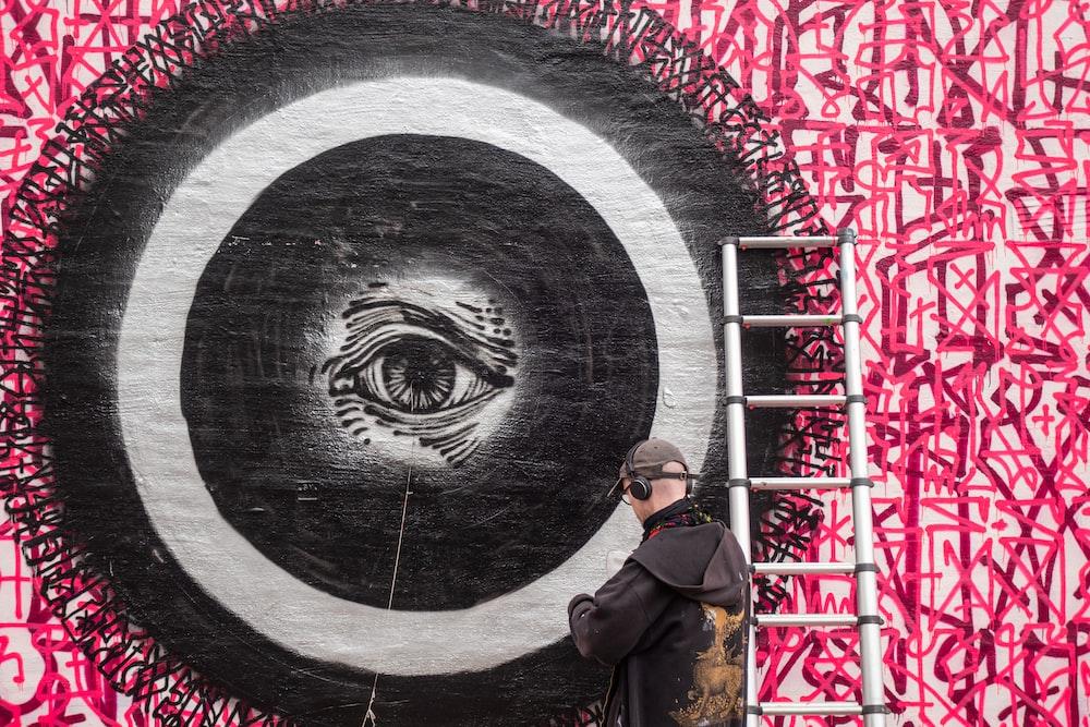 graffiti of a black and white eye