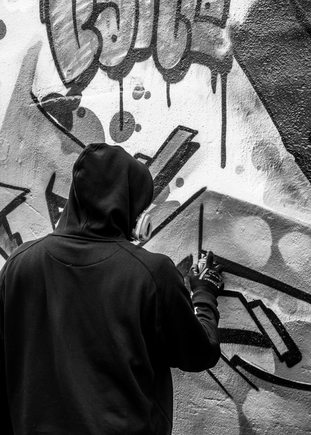 grayscale photography of person painting on wall