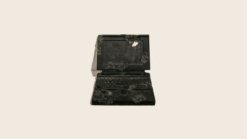 black laptop on white surface