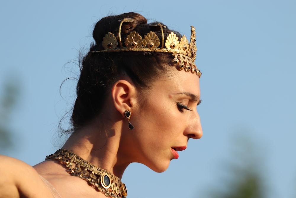 woman wearing gold crown