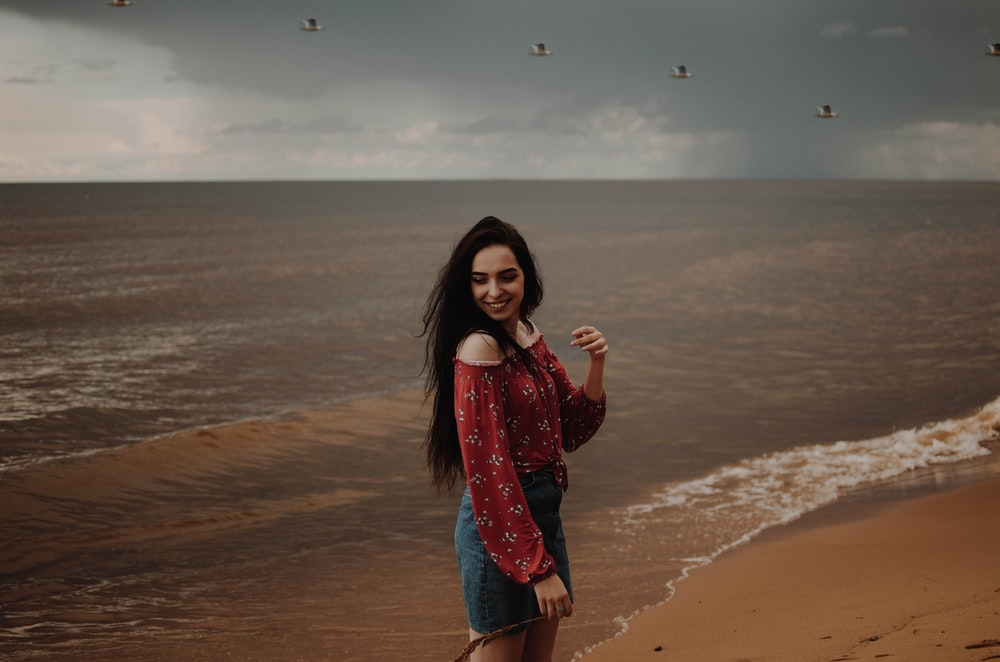 woman taking photo at the back of seashore photo background