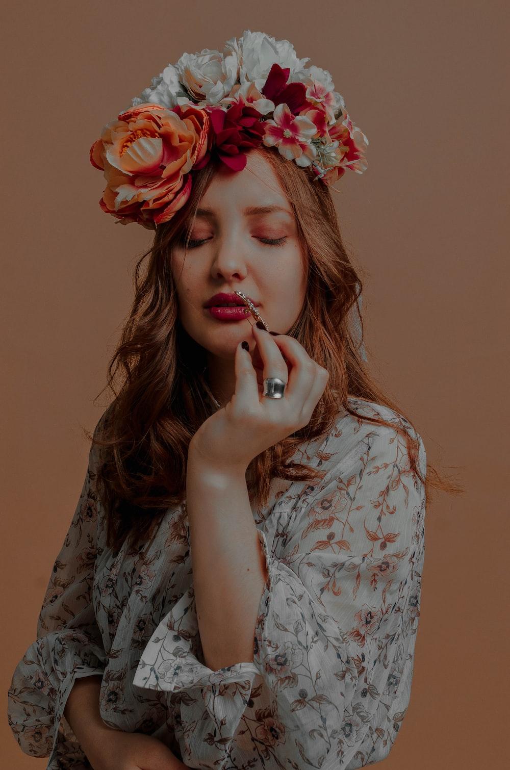flowers on woman's head