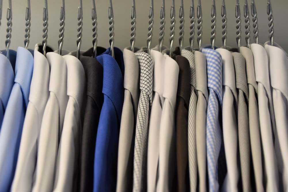 assorted color dress shirt lot on clothes hangers
