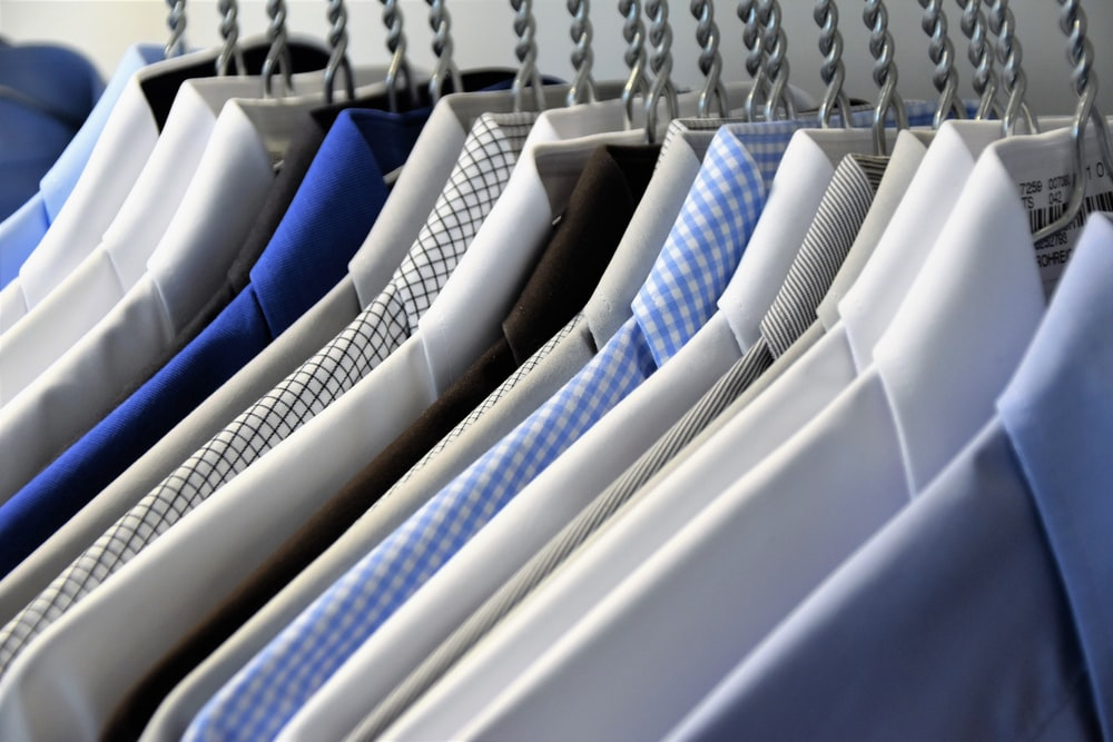 hanged assorted-color dress shirts