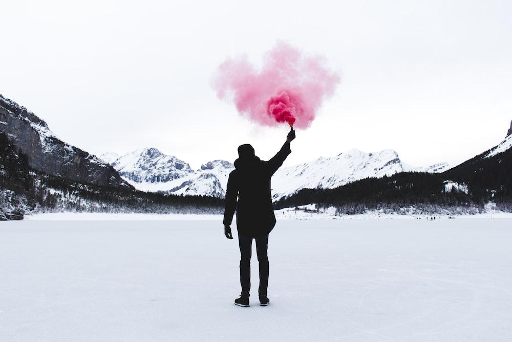 man holding pink powder