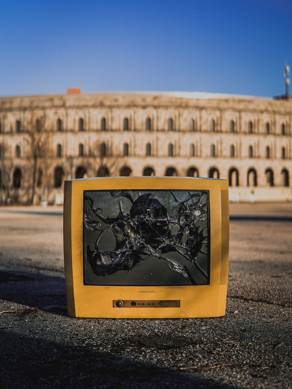 cracked beige monitor on the street