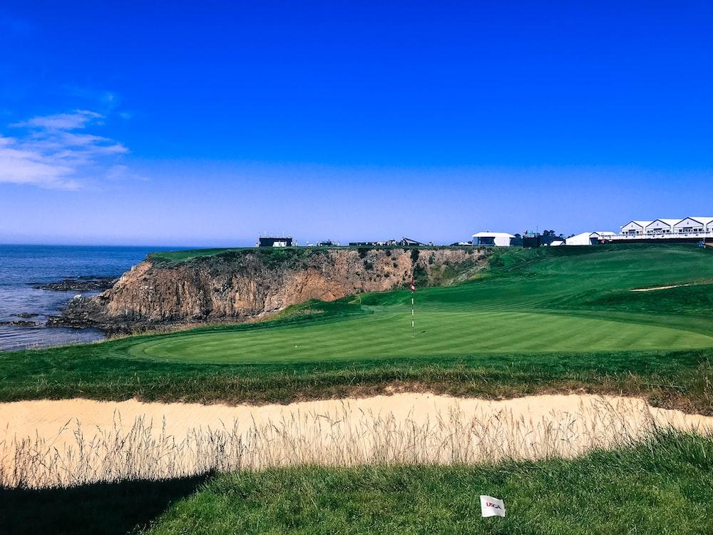 golf field near cliff overlooking ocean