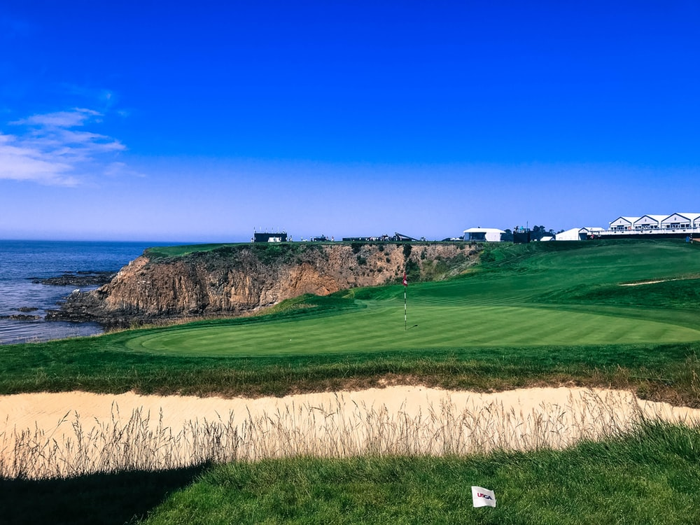 golf field near cliff overlooking ocean