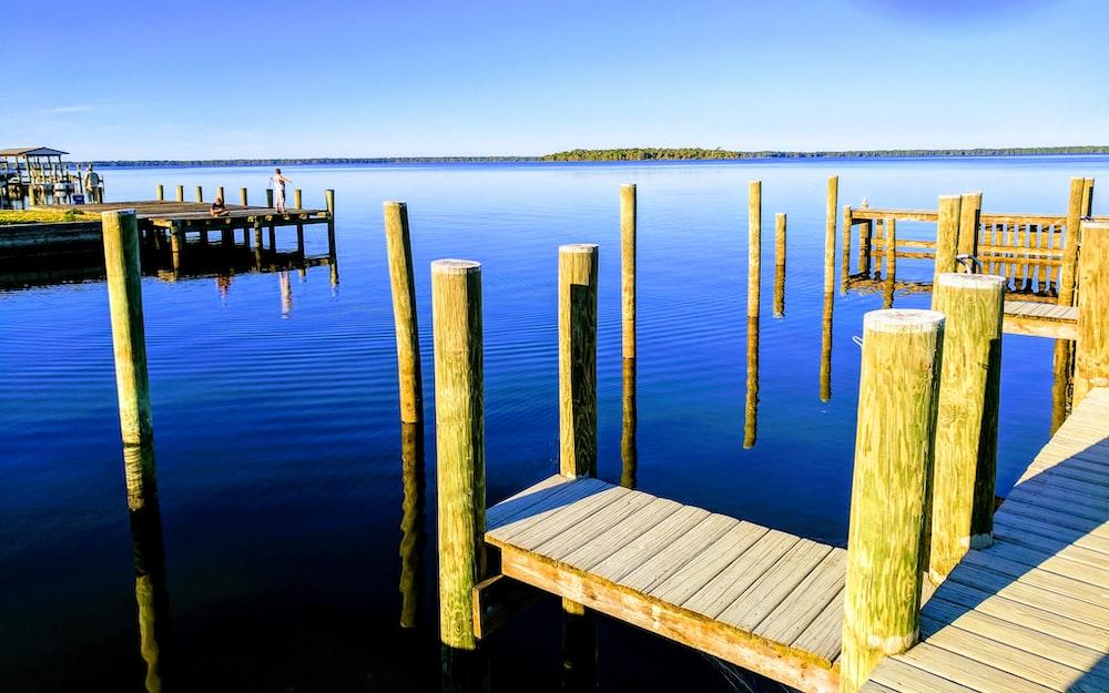 beige wooden dock near ocean