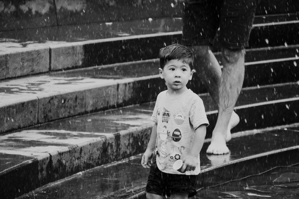 grayscale photo of boy
