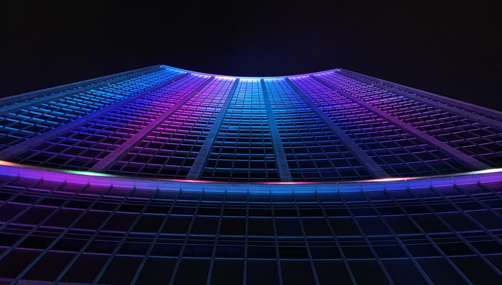 multicolored curtain wall building during nighttime