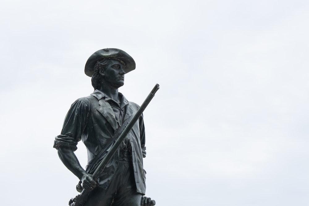 man wearing cap statue