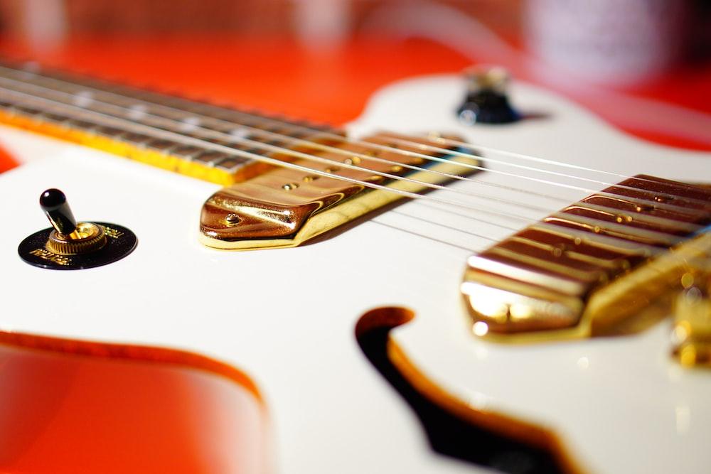 selective focus photo of guitar