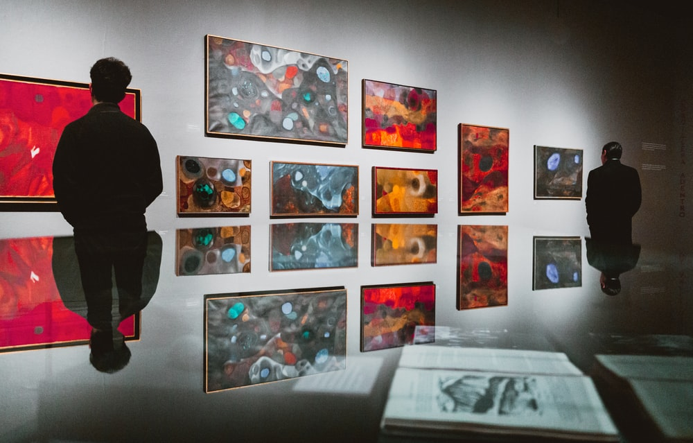 man facing artworks