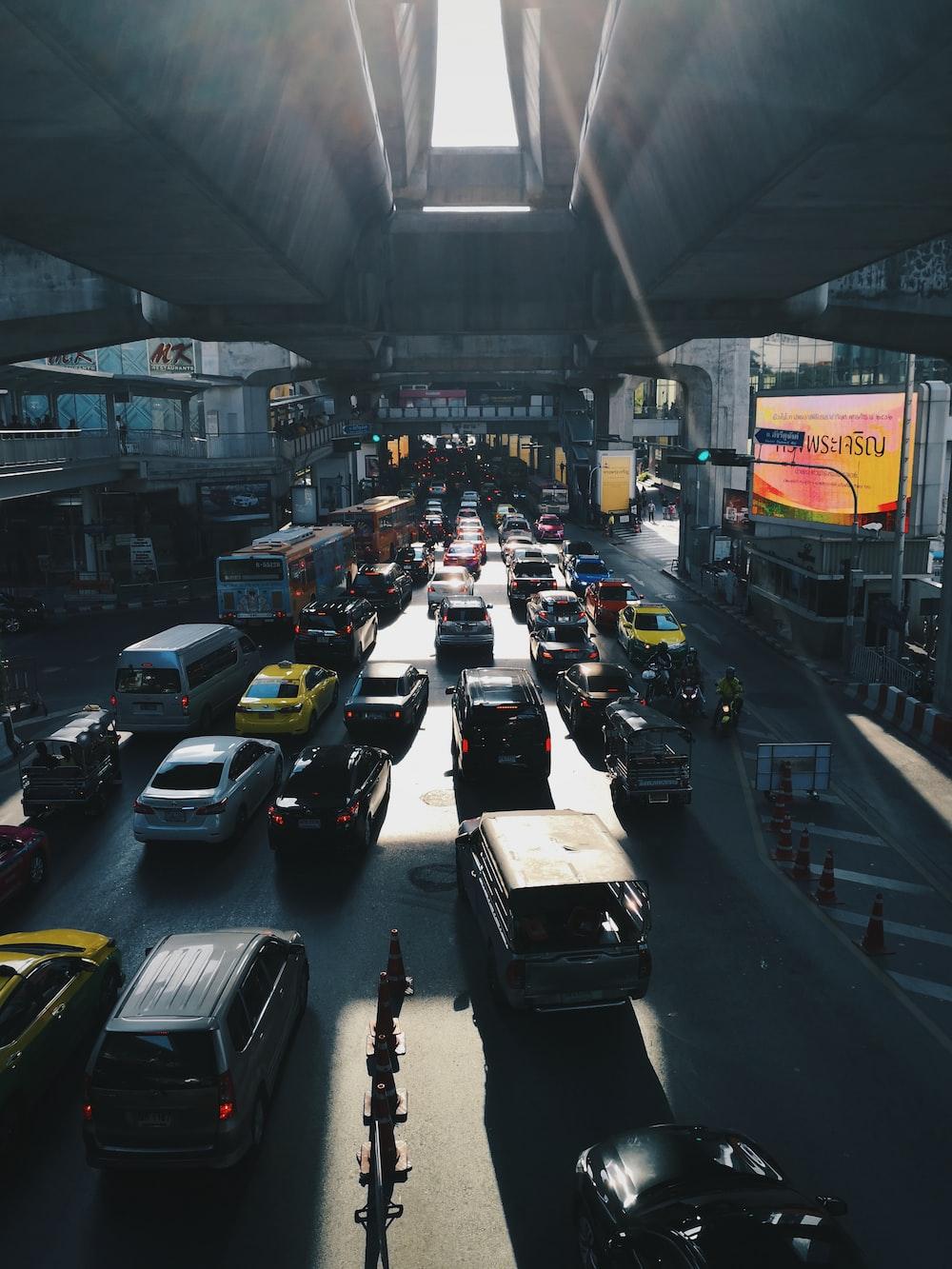 cars under concrete bridge