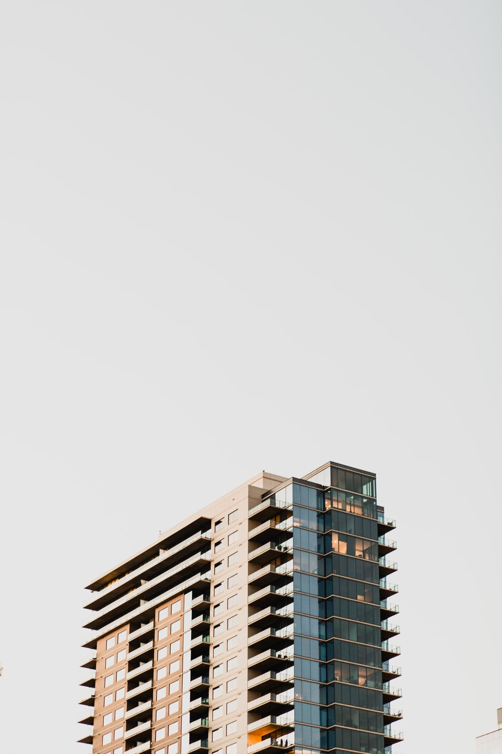low-angle photography of gray and brown concrete high-rise building during daytime