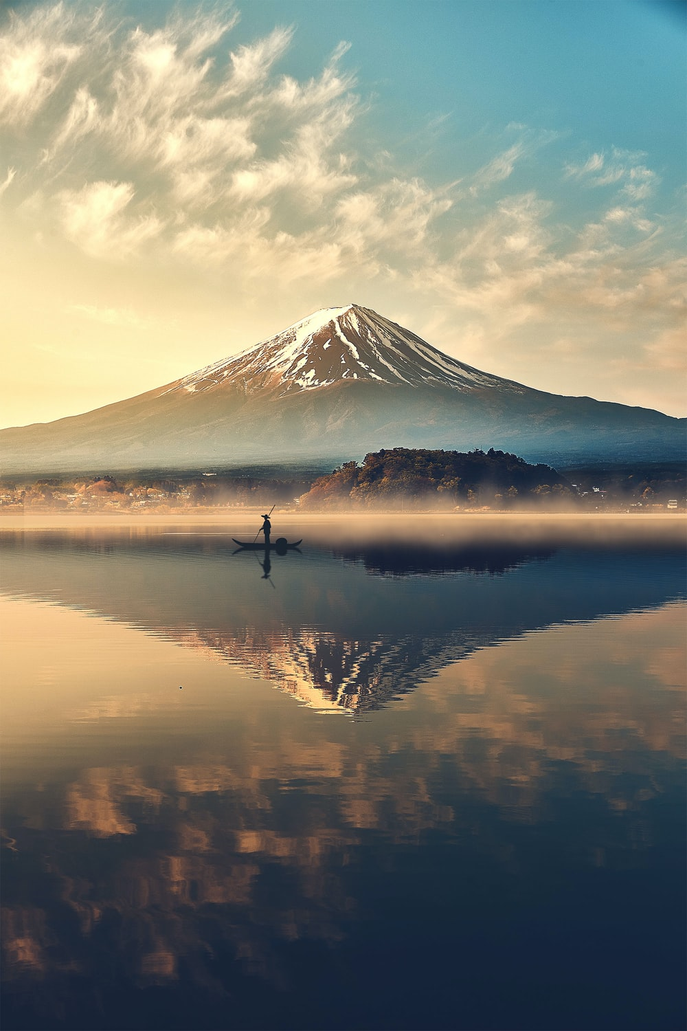 reflection of mountain on body of water