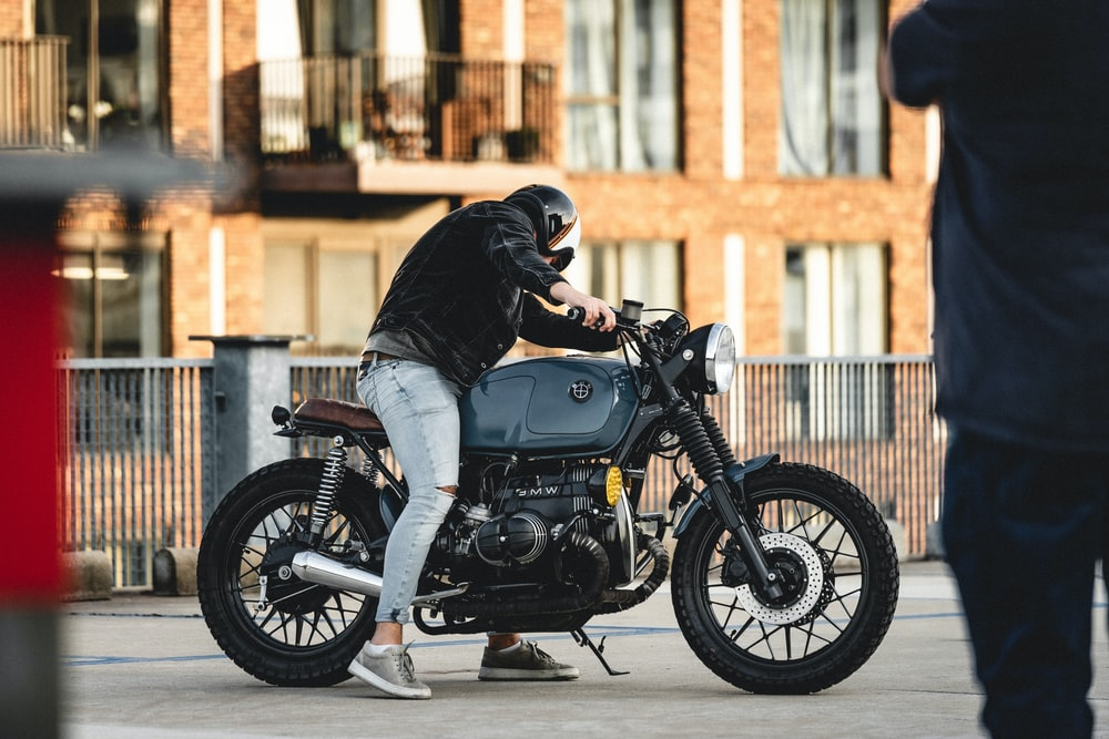 man on standard motorcycle