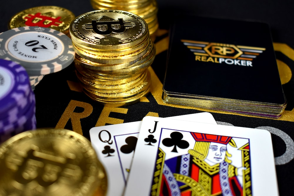 playing cards and Bitcoins near Poker set