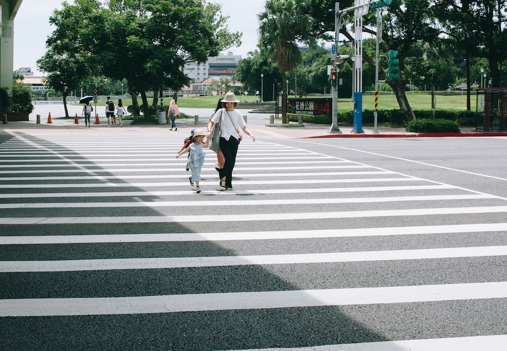 woman and child crossing on pedestrian