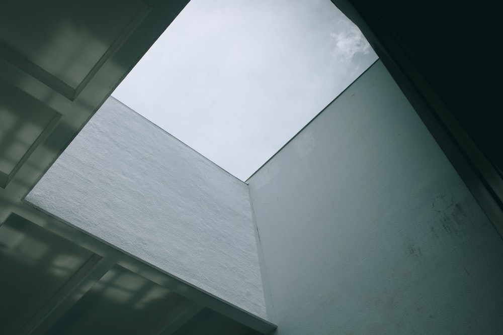 low-angle photography of gray concrete interior