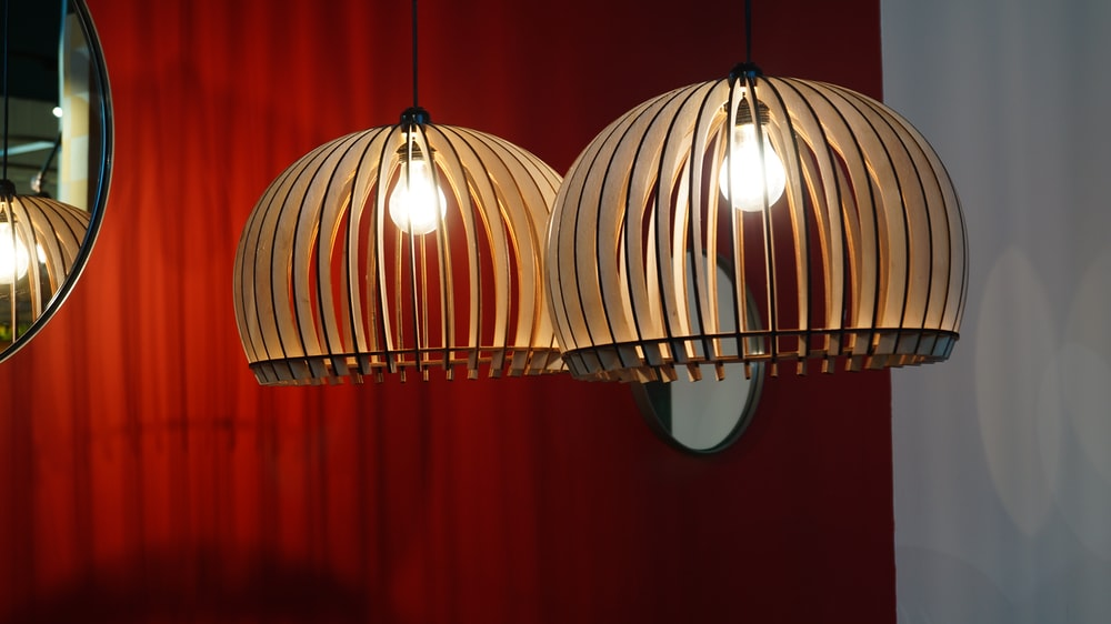 two lighted white pendant lamps