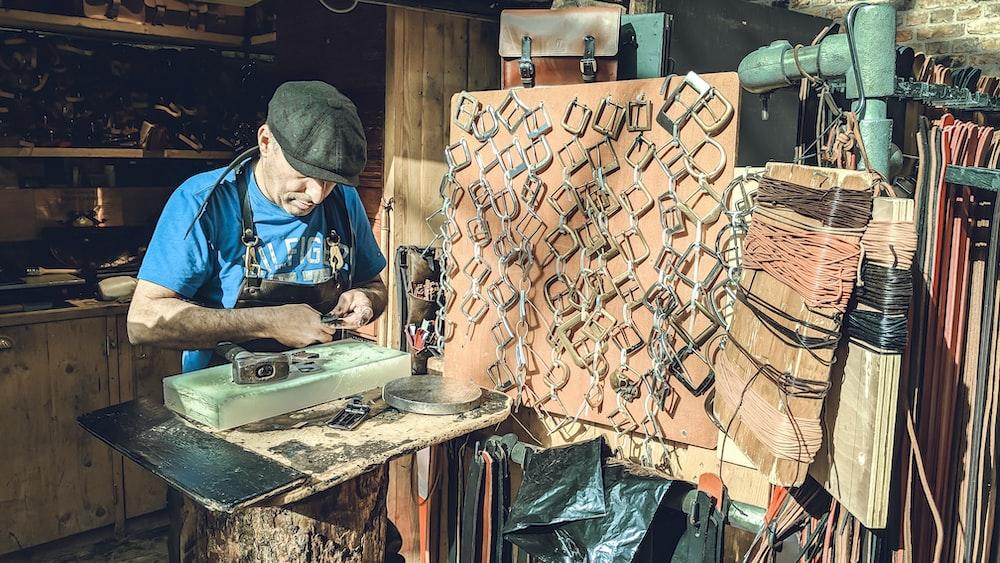 man making belt buckles