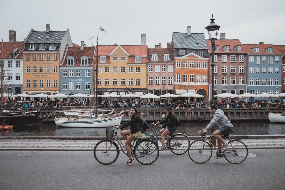 three people riding bicycles