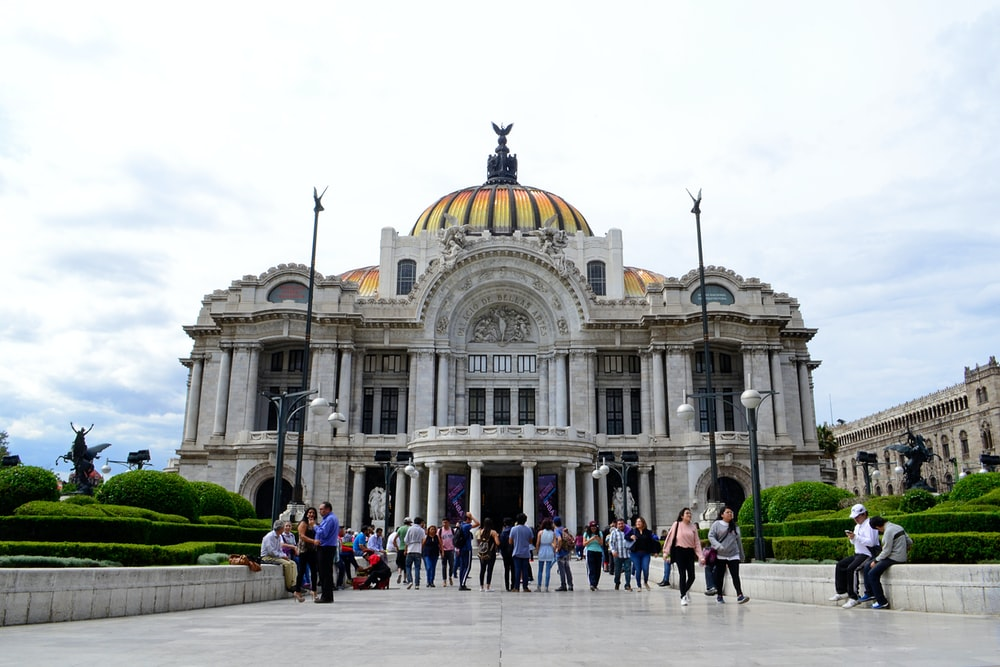 people walking outside dome building