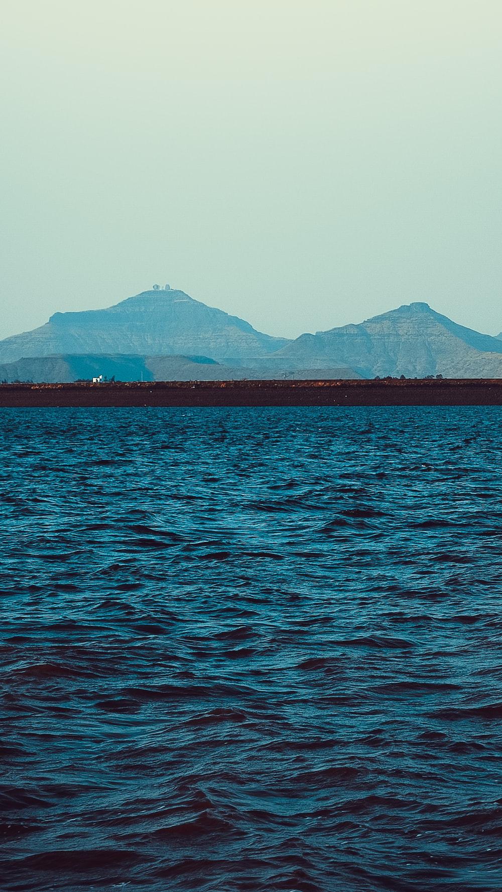 blue calm sea viewing mountain