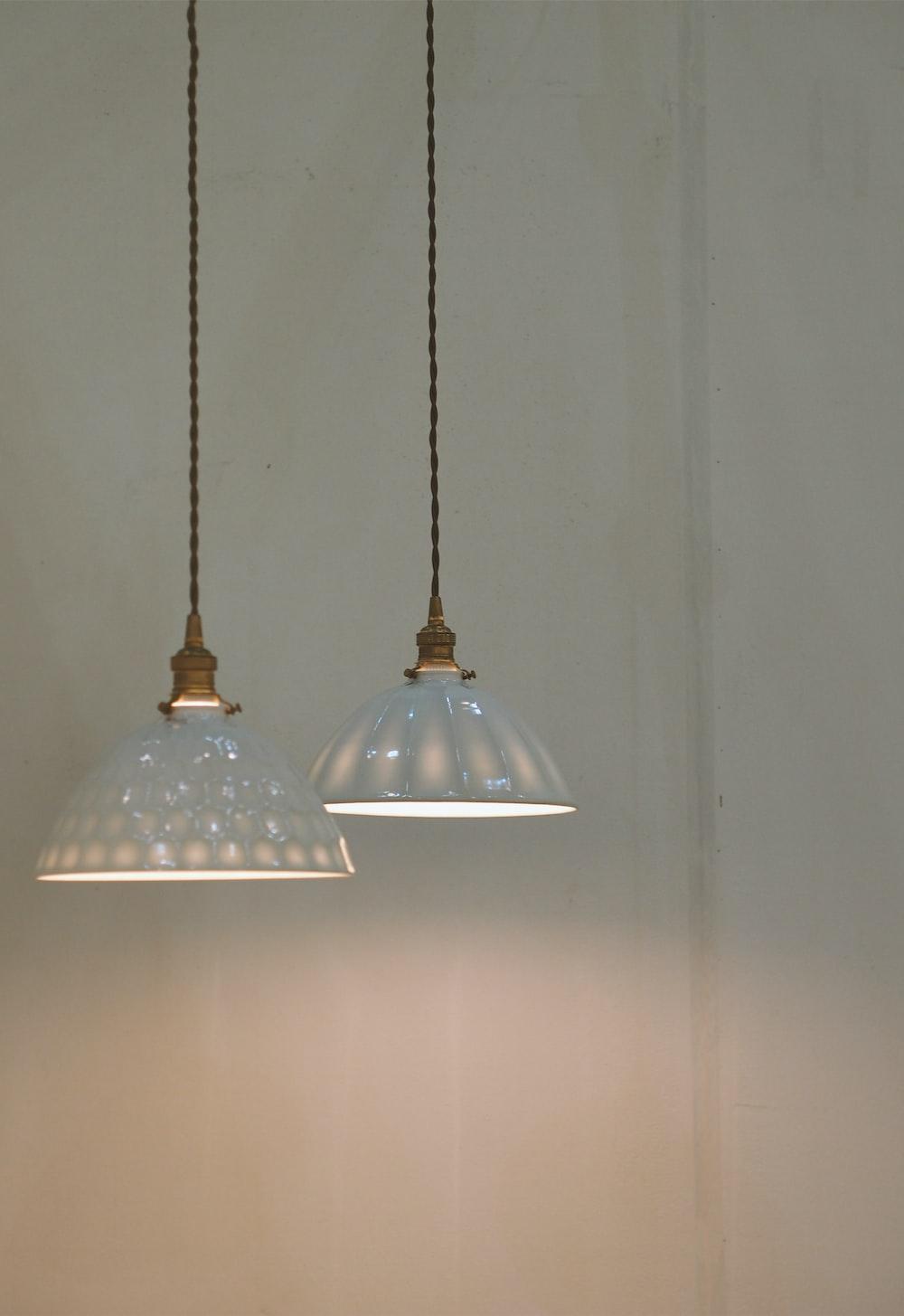 two white pendant lamps