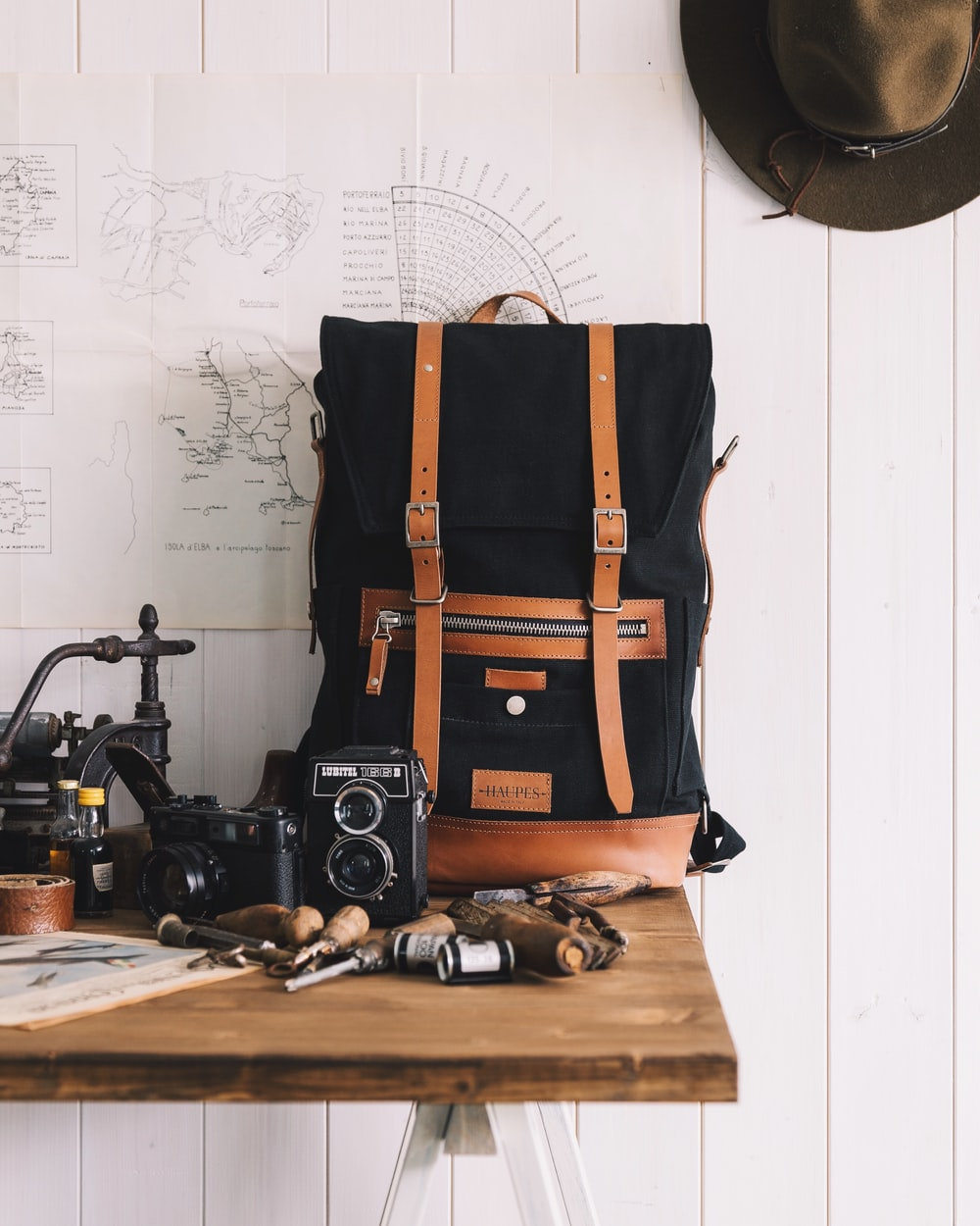 black and brown backpack on table