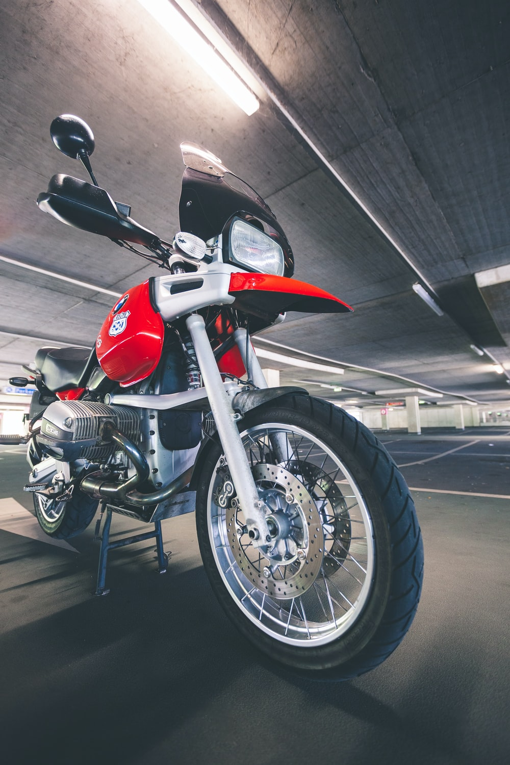red dual-sport motorcycle