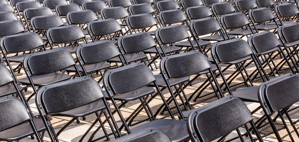 black folding armless chair lot