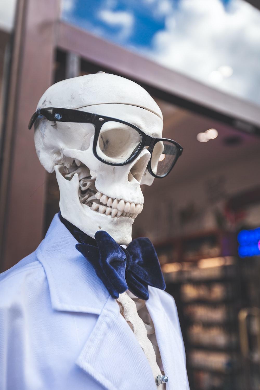 skeleton wearing eyeglasses and blue collared top