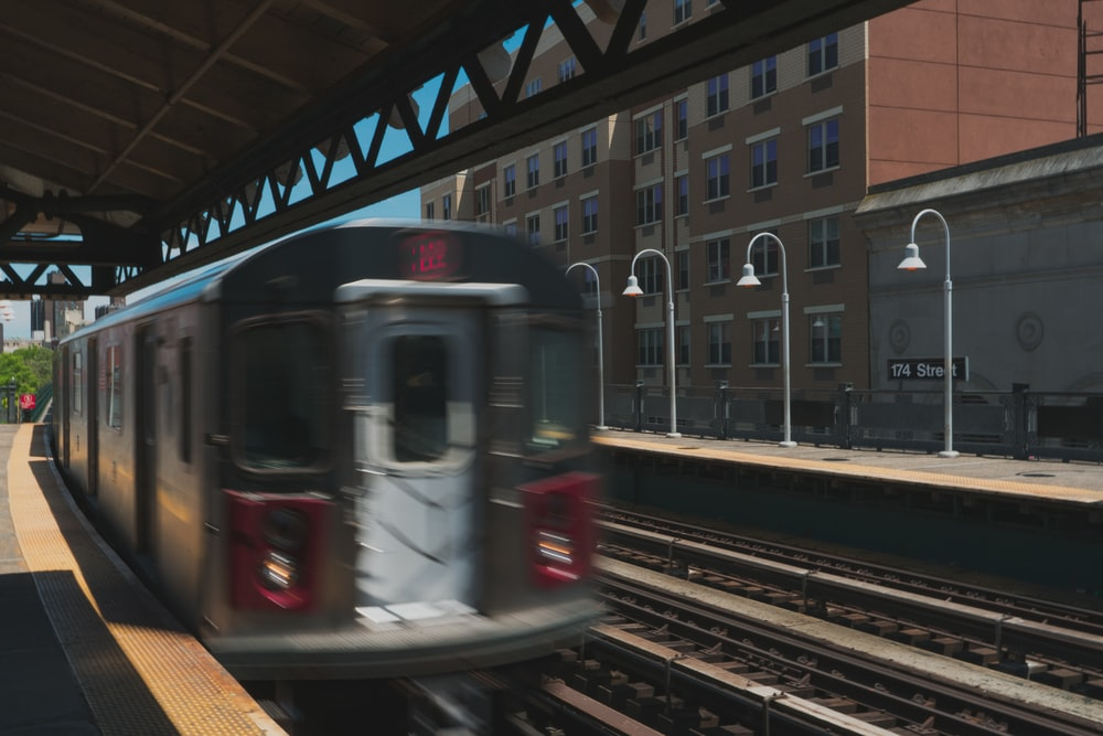 train running in a railway during daytime