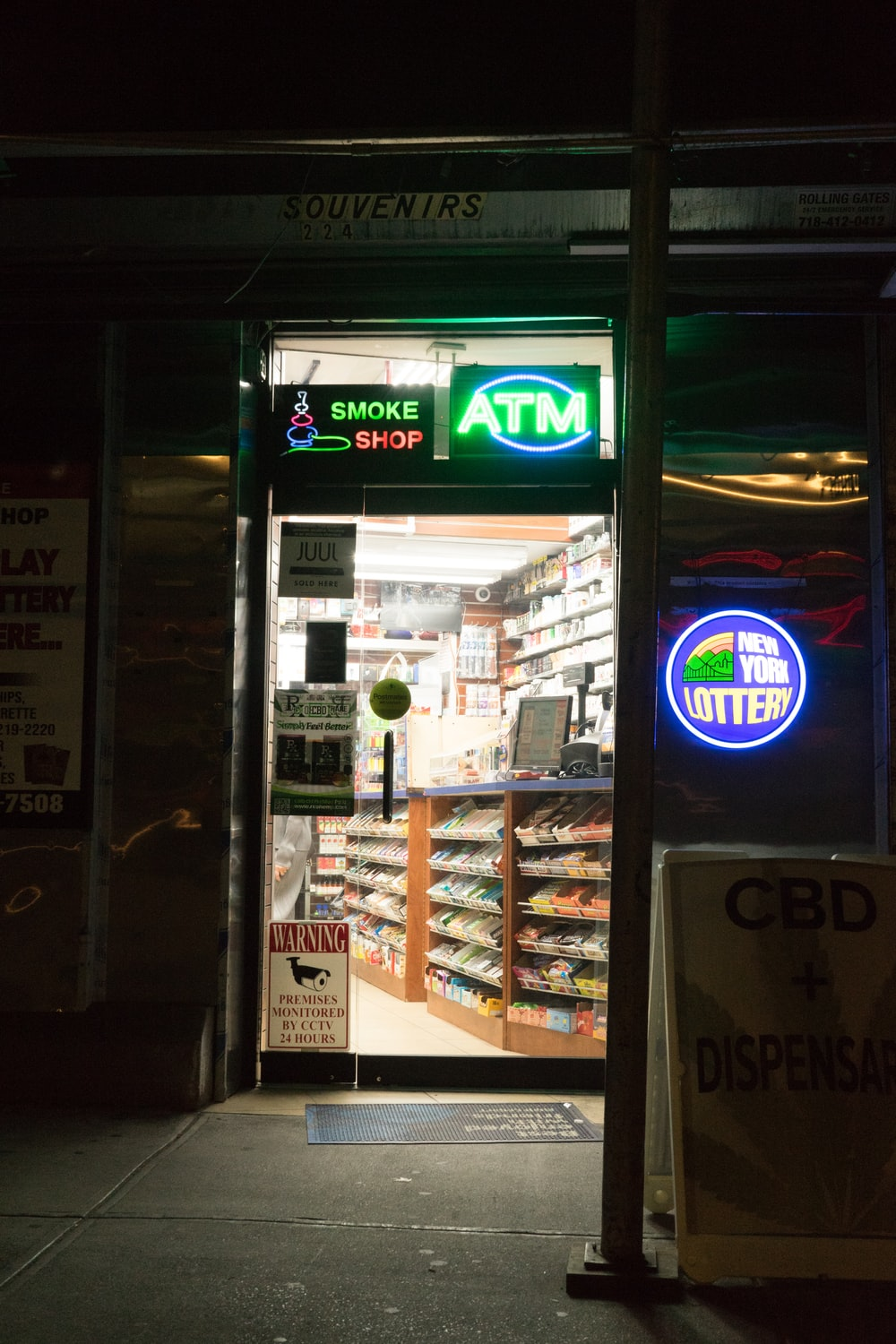 glass panel door with green ATM signage