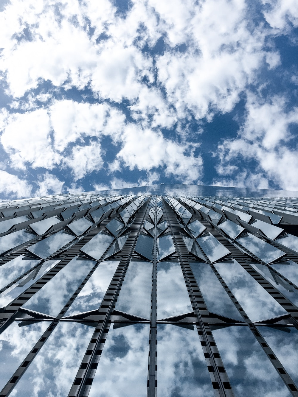 close-up photography of high-rise building under cloudy sky during daytime