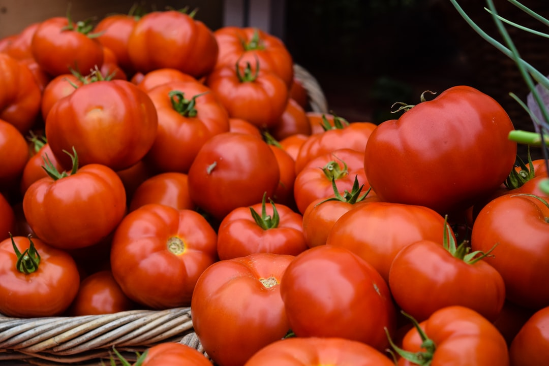 Taken at a farmer's market; peak ripe summer tomatoes, nothing better! The deep red color is was drew me to them.