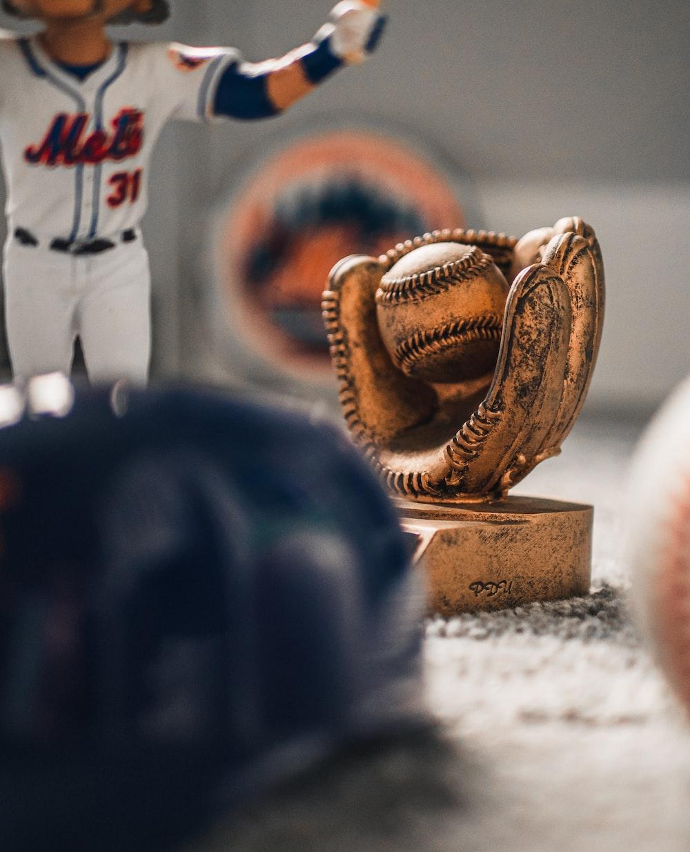 beige baseball with mitt