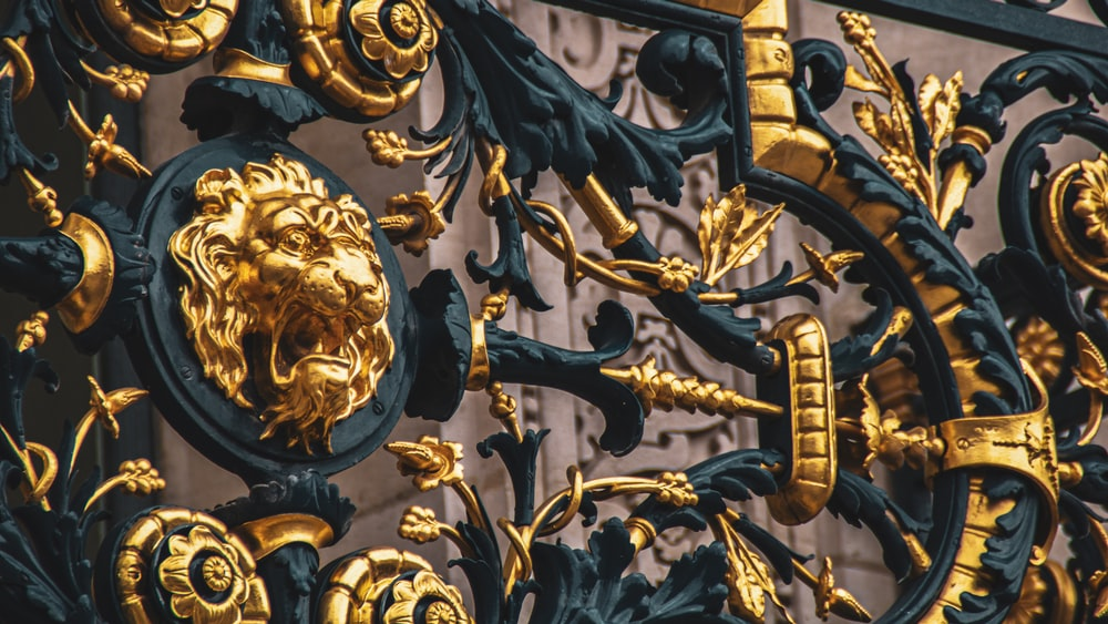 gold and black lion and sword statues