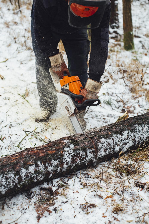 white and orange chainsaw